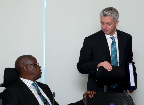 Peter Chingoka, chairman of Zimbabwe Cricket, chat with David Richardson, Chief Executive of the ICC.
