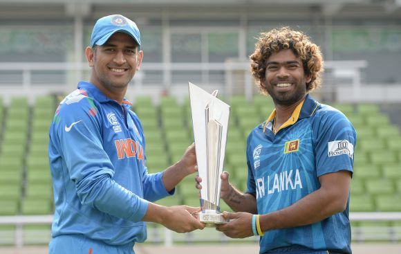 Mahendra Singh Dhoni and Lasith Malinga pose with the WT20 trophy before the final.