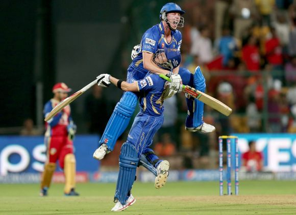 James Faulkner celebrates with Steven Smith after winning the game