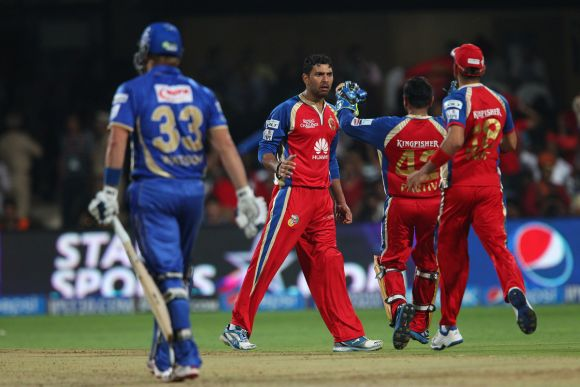 Yuvraj Singh celebrates after dismissing Shane Watson
