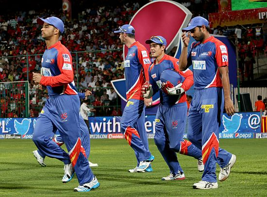 Delhi Daredevils players walk onto the pitch