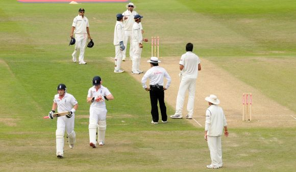 The Indian team appeals for a run-out as England's Ian Bell (left) leaves the field thinking it is tea during the second cricket Test at Trent Bridge in Nottingham