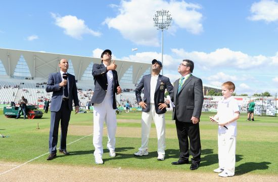 England captain Alastair Cook tosses the coin alongside Mahendra Singh Dhoni of India ahead of day one of 1st Investec Test match between England and India at Trent Bridge