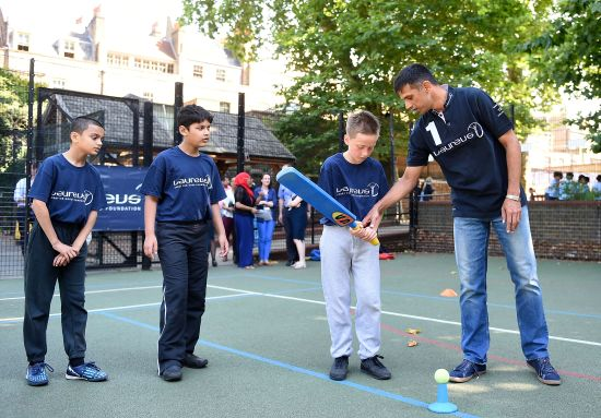 Laureus Academy Member Rahul Dravid interacts with children