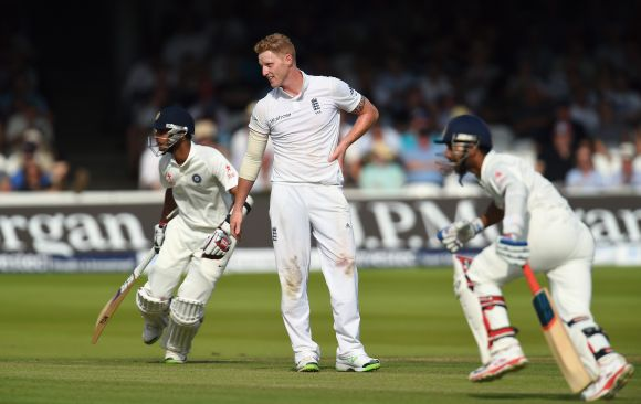 Ajinkya Rahane (right) and Bhuvneshwar Kumar pick up runs as bowler Ben Stokes looks on
