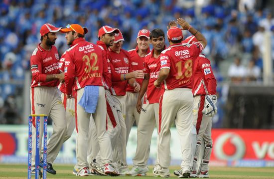 Kings XI Punjab players celebrate after picking up a wicket