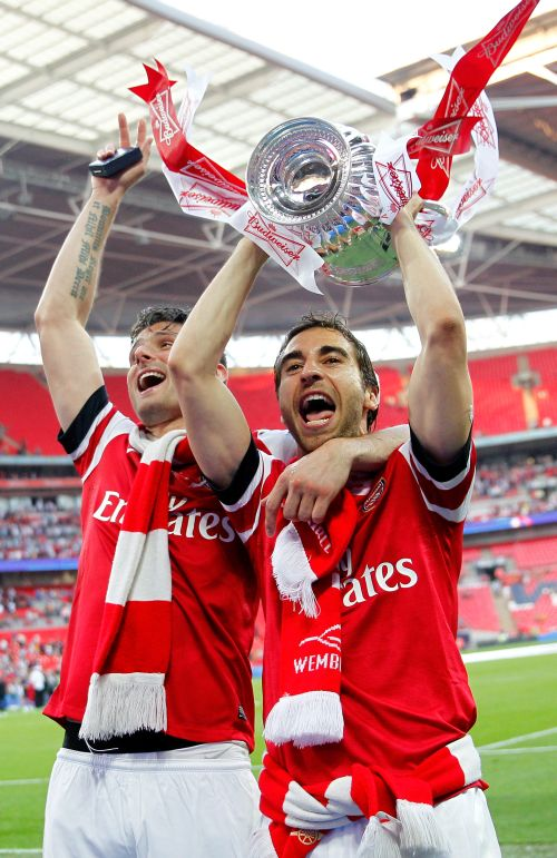 Olivier Giroud and Mathieu Flamini of Arsenal celebrate victory with the trophy after the FA Cup