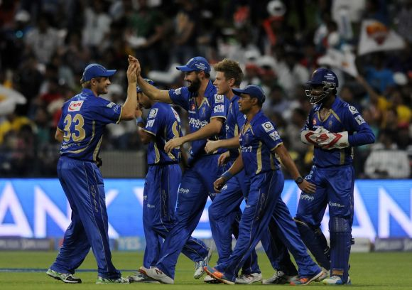 Rajasthan Royals players celebrate after picking a wicket