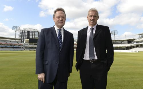 England's Peter Moores (R) poses for a photograph with Managing Director of England cricket Paul Downton