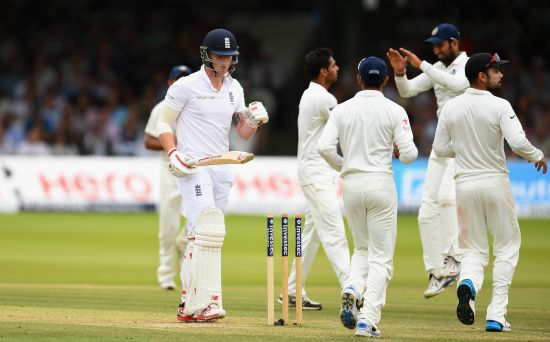 Bhuvneshwar Kumar celebrates after dismissing Ben Stokes