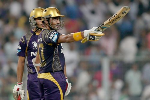 Robin Uthappa reacts after completing his half-century