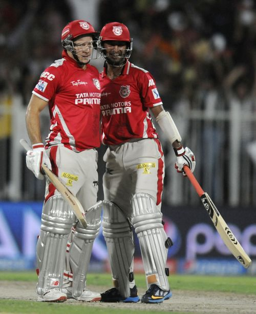 David Miller (left) and Cheteshwar Pujara celebrate victory