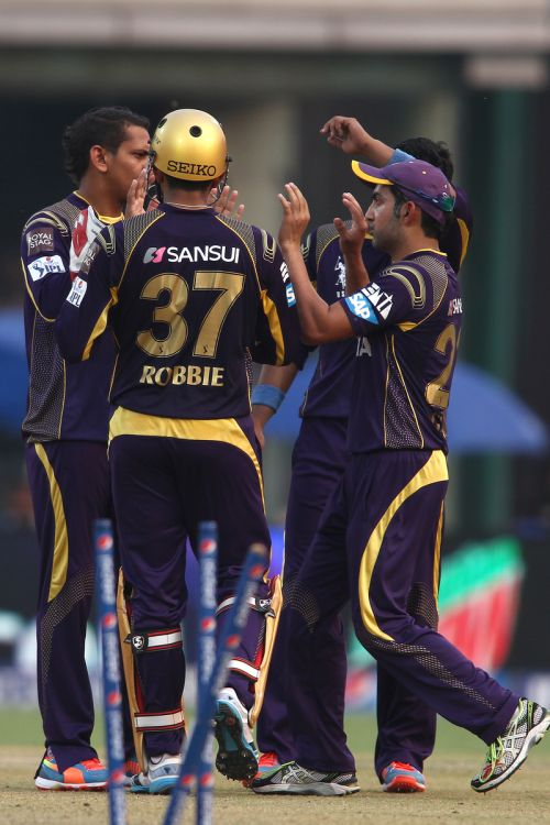Gautam Gambhir celebrates after a fall of a wicket