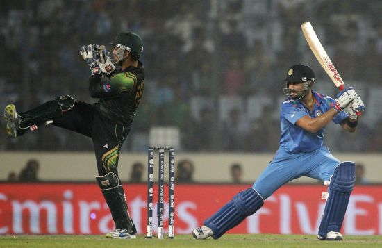 Virat Kohli hits one to the boundary