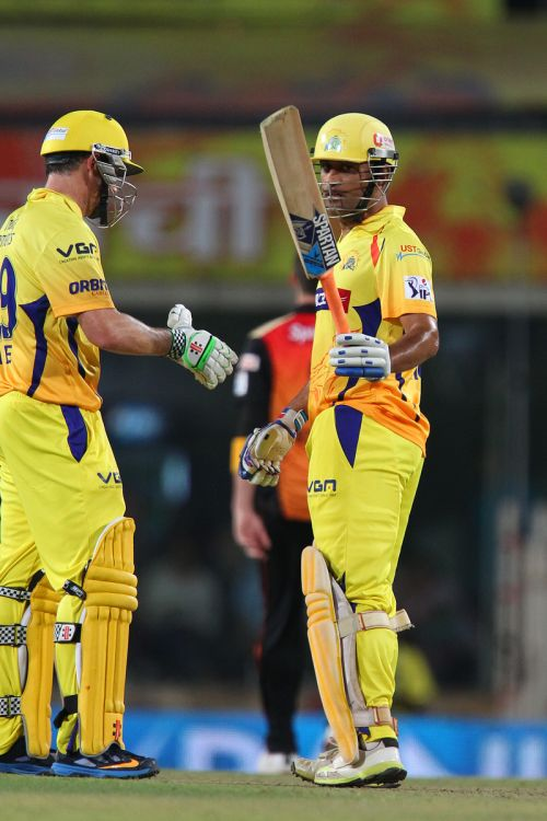 Mahendra Singh Dhoni reacts after completing his half-century.