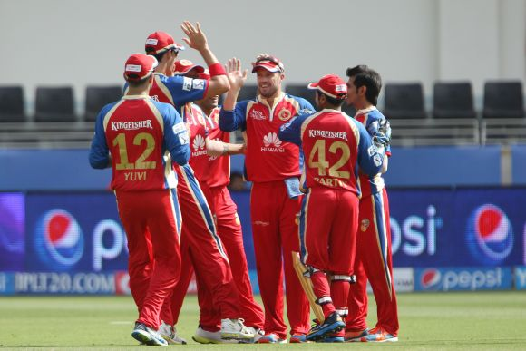 Royal Challengers Bangalore players celebrate after picking up a wicket