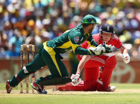 Ben Stokes of England looks to play a sweep shot past Matthew Wade