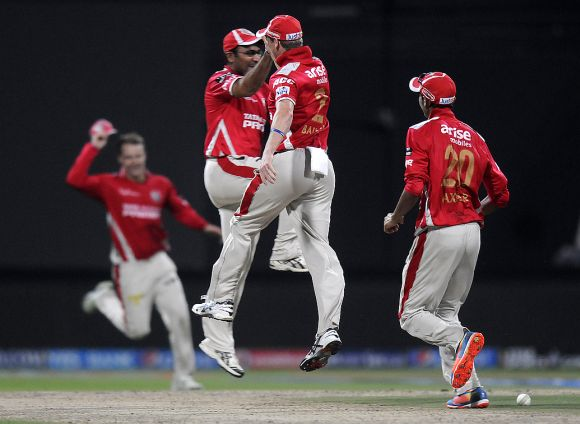 George Bailey celebrates with Virender Sehwag after a fall of a wicket