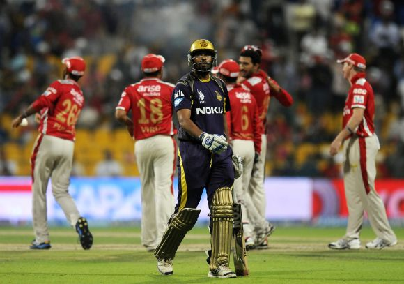 Yusuf Pathan walks back after being dismissed