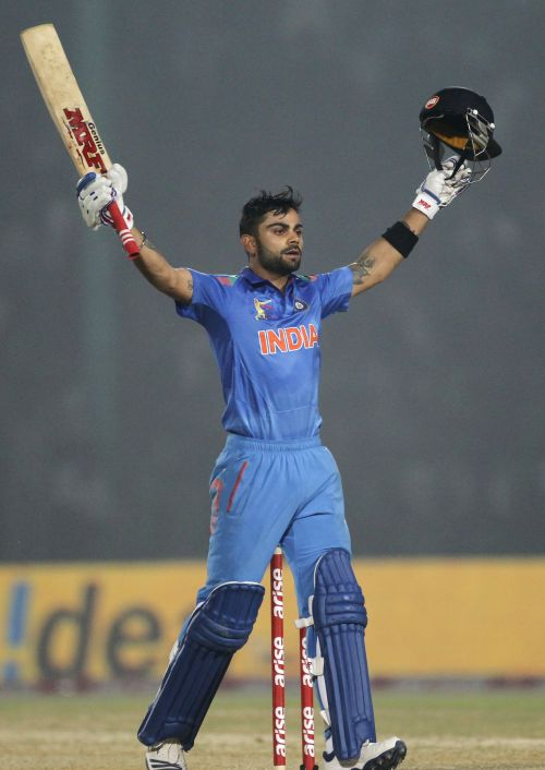 Virat Kohli celebrates after reaching his century
