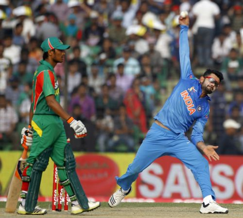Virat Kohli bowls during the match against Bangladesh on Wednesday