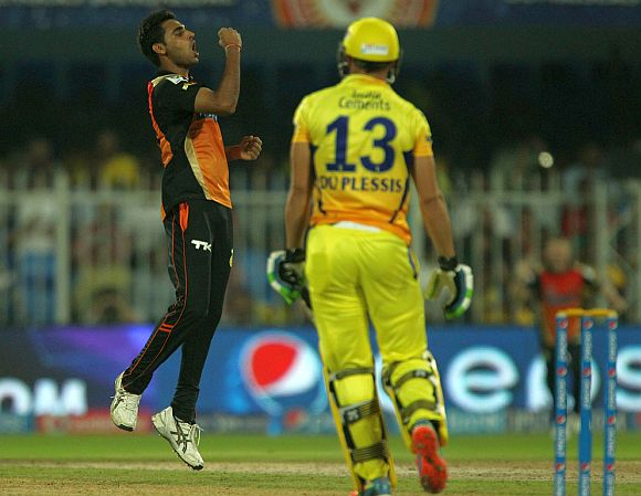 Bhuvneshwar Kumar celebrates after dismissing Faf du Plessis