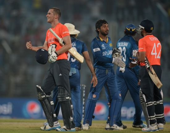 Alex Hales celebrates after winning the game for England