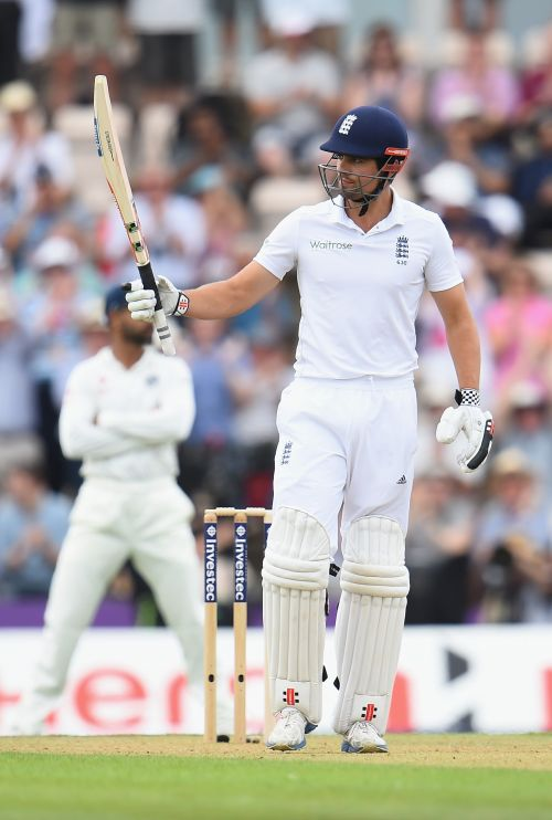 Alastair Cook of England salutes the fans as he reaches 50 not out during Day 1 of the 3rd Investec Test match between England and India