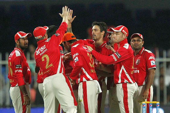 Kings XI players celebrate after picking up a wicket