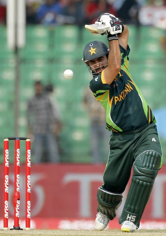 Pakistan's Ahmed Shehzad plays a ball against Afghanistan during their Asia Cup match in Fatullah