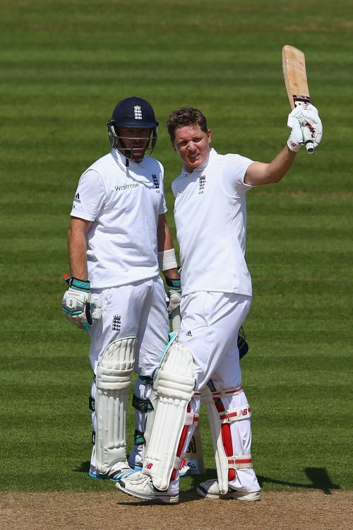 Gary Ballance (R) of England raises his bat after reaching his 150 alongside Ian Bell