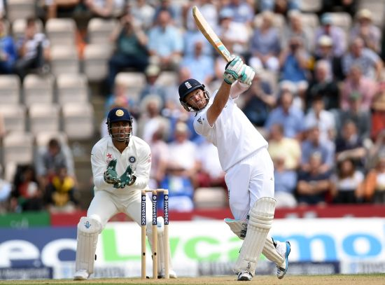 England batsman Ian Bell hits Jadeja for six runs watched by India wicketkeeper M.S. Dhoni during day two of the 3rd Investec Test