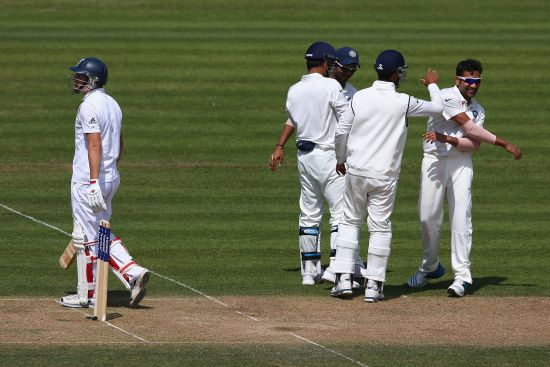 Gary Ballance of England is dismissed caught by wicketkeeper MS Dhoni off the bowling of Rohit Sharma (R) of India