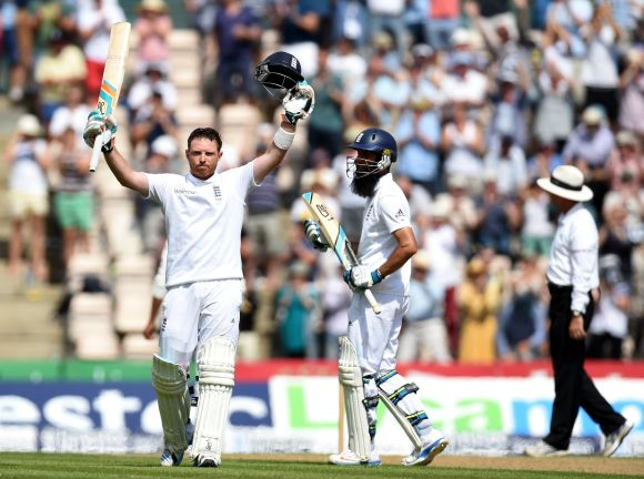 England batsman Ian Bell celebrates his century as Moeen Ali applauds during day two of the 3rd Investec Test at Ageas Bowl