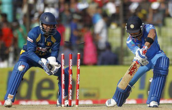 Virat Kohli is clean bowled by Ajantha Mendis