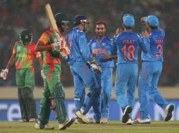 Amit Mishra is congratulated by teammates after picking a wicket