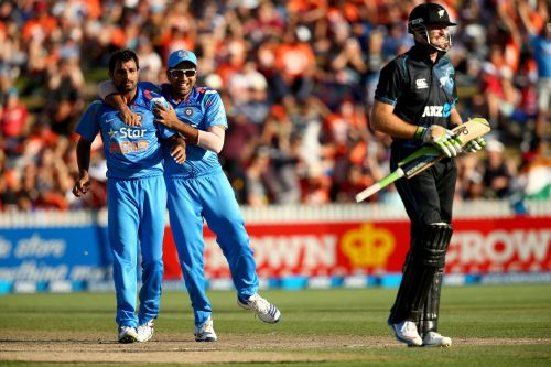 Mohammad Shami celebrates after dismissing Martin Guptill
