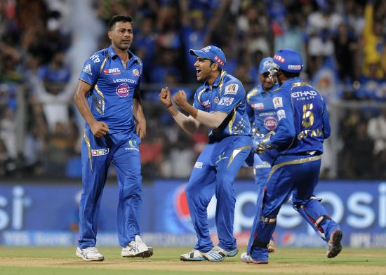 Mumbai Indians players celebrate after picking up a wicket.