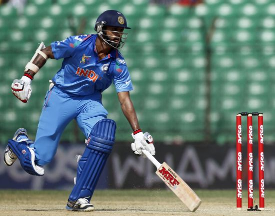 Shikhar Dhawan runs between the wickets against Sri Lanka