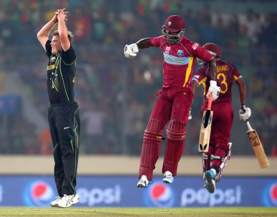 Darren Sammy celebrates after hitting the winning runs against Australia