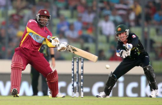 Chris Gayle bludgeons one through the off side