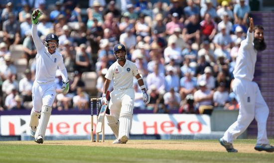 England bowler Moeen Ali and wicketkeeper Jos Buttler appeal in vain for the wicket of India batsman Ajinkya Rahane