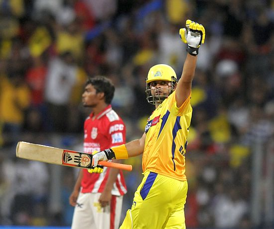 Suresh Raina celebrates after completing his half-century.
