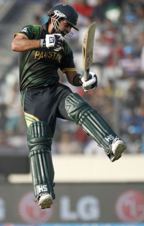 Ahmed Shehzad celebrates after picking up a wicket