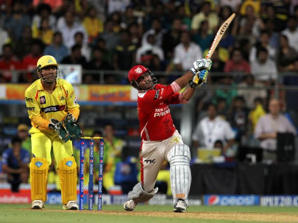 Virender Sehwag hits a six.