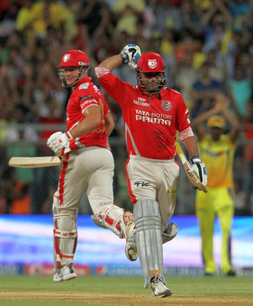 Virender Sehwag rejoices after completing his century.