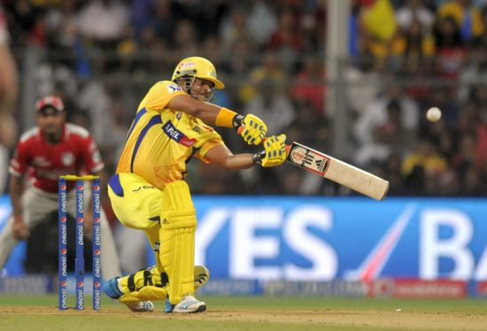Suresh Raina hits a six.