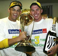 Brett Lee and Adam Gilchrist (left) with the World Cup