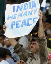 A Pakistani national holds up a poster