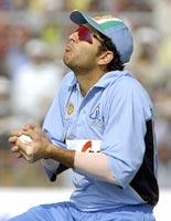 Yuvraj Singh takes a catch during the VB series